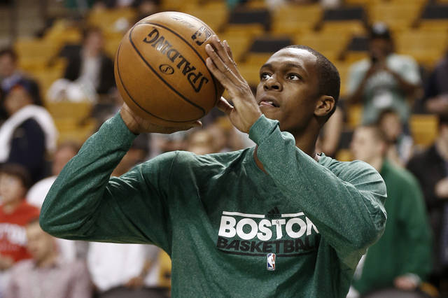 Injured Boston Celtics point guard Rajon Rondo shoots baskets before Game 3 of a first-round NBA basketball playoff series against the New York Knicks in Boston, Friday, April 26, 2013. (AP Photo/Winslow Townson)