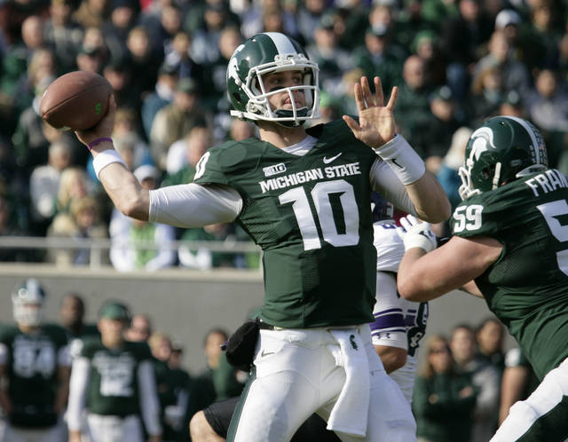 Michigan State quarterback Andrew Maxwell (10) throws a pass as Michigan State's Dan France (59) blocks Northwestern's Quentin Williams during the first quarter of an NCAA college football game, Saturday, Nov. 17, 2012, in East Lansing, Mich. (AP Photo/Al Goldis)
