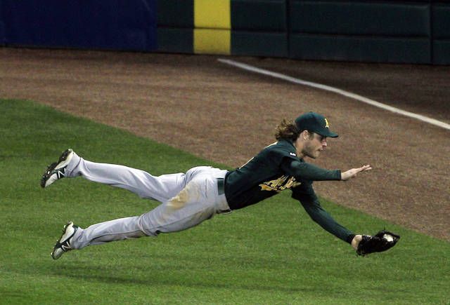 Oakland Athletics right fielder Josh Reddick catches a ball hit by Detroit Tigers' Austin Jackson during the fifth inning of Game 1 of the American League division baseball series, Saturday, Oct. 6, 2012, in Detroit. (AP Photo/Carlos Osorio)