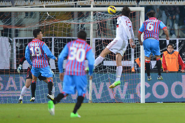 Catania defender Nicola Legrottaglie, right, scores on a header during the Serie A soccer match between Catania and AC Milan at the Angelo Massimino stadium in Catania, Italy, Friday, Nov. 30, 2012. (AP Photo/Carmelo Imbesi)