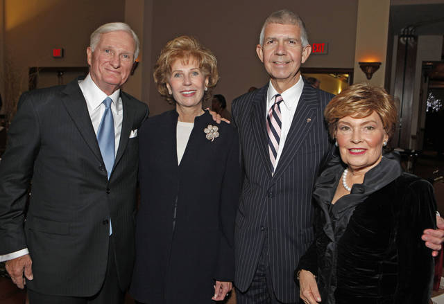 W. DeVier Pierson, Sarah Hogan, Justice Steven Taylor, and Pierson's wife Shirley attend the Order of the Owl Hall of Fame dinner and induction in the Oklahoma Memorial Union Ballroom on Tuesday, Nov. 8, 2011, in Norman, Okla.  Photo by Steve Sisney, The Oklahoman