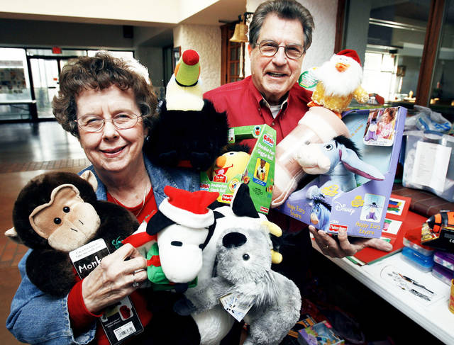 Charmaine and Bob Magarian show some of the toys collected for the 20th annual Norman Community Christmas Dinner in 2006.  Photo by Steve Sisney, The Oklahoman Archives