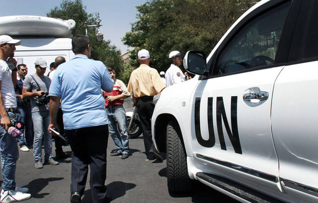 ADDS THE NAMES OF THREE TOP OFFICIALS KILLED IN THE ATTACK - In this July 5, 2012 photo, a U.N. observers vehicle arrives at the site where a suicide attack hit the National Security building in Damascus, Syria. Another attack occurred at the building Wednesday, July 18, 2012, during a meeting of Cabinet ministers and senior security officials. Syria's state-run TV confirmed the deaths of Syrian Defense Minister Dawoud Rajha, President Bashar Assad's brother-in-law, Gen. Assef Shawkat, and former defense minister Hassan Turkmani. (AP Photo/Bassem Tellawi) A UN observers vehicle arrives at the site where a suicide attack hit the National Security building in Damascus, Syria site in Damascus, Syria, Thursday, July 5, 2012. Syria's state-run TV said Wednesday that President Bashar Assad's brother-in-law was among the dead in a suicide bombing at the National Security building during a meeting of Cabinet ministers and senior security officials in Damascus. (AP Photo/Bassem Tellawi)