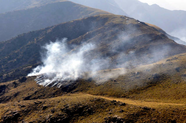In this Nov. 26, 2011 photo provided by Pakistan's Inter Services Public Relations department, smoke rises after a reported NATO airstrike in Pakistan's tribal area of Mohmand, along the Afghanistan border. Pakistan has withdrawn from an international conference on stabilizing Afghanistan to protest the deadly attack by American forces on its troops, widening a fresh rupture in ties with a nominal ally that is endangering the U.S. plan for gradually ending the war. (AP Photo/Inter Services Public Relations Department)