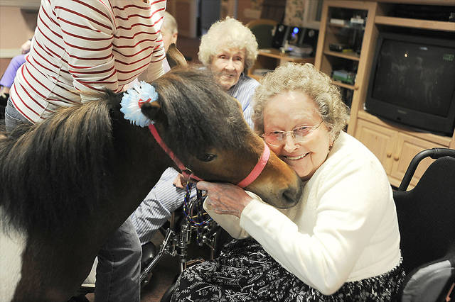 Village at Skyline resident Frances Gates gives Willow a hug during a visit.MCCLATCHY-TRIBUNE PHOTO