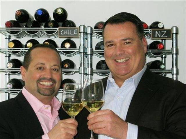 This April 15, 2012 publicity photo provided by World Wine Guys LLC shows Jeffrey Jenssen, right, and Michael DeSimone, World Wine Guys LLC, toasting with Craggy Range Chardonnay from New Zealand in New York. (AP Photo/World Wine Guys LLC, Geoffrey Michaels)