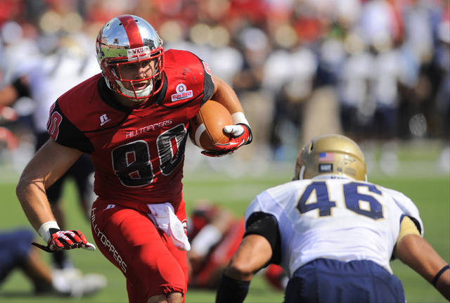 Western Kentucky Hilltoppers tight end Mitchell Henry (80) carries the ball for extra yards with Navy Midshipmen linebacker Chris Johnson (46) defending during the first half of an NCAA college football game on Saturday, Sept. 28, 2013, in Bowling Green, Ky. (AP Photo/Joe Imel)