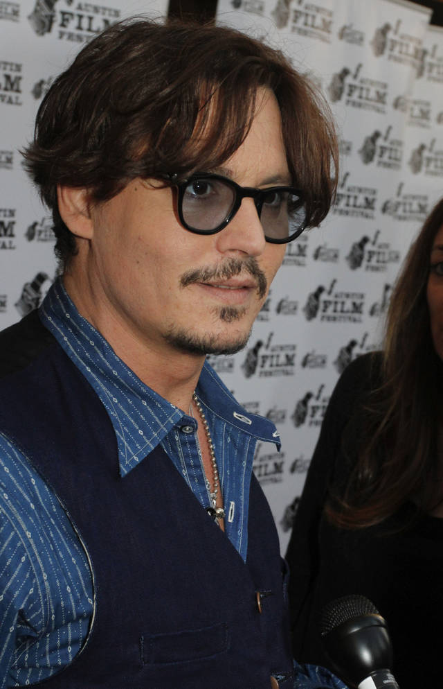 In this handout photo provided by the Austin Film Festival, actor Johnny Depp arrives at a screening of his new film 'The Rum Diary' during the Austin Film Festival and Conference, Friday, Oct 21, 2011, in Austin, Texas.(AP Photo/Austin Film Festival, Jack Plunkett) ORG XMIT: TXJP402