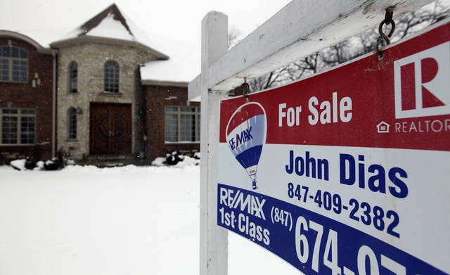 "In this Wednesday, Feb. 27, 2013, photo, a ""for sale"" sign is seen outside a home in Glenview, Ill., Average U.S. rates on fixed mortgages moved closer to historic lows this week, a trend that has helped drive a rebound in home sales.  (AP Photo/Nam Y. Huh)"