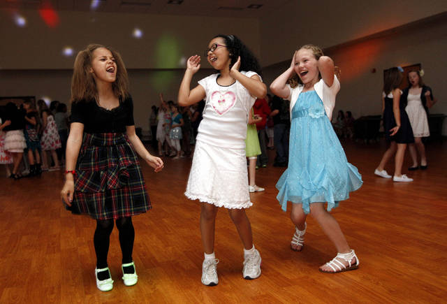 From left to right Alajaha Stewart, Genesis Walko and Harley Austin dance during the Midwest City Parks and Recreation's Spring Fling dance in Midwest City, Okla., Friday, March 16, 2012. Photo by Sarah Phipps, The Oklahoman.