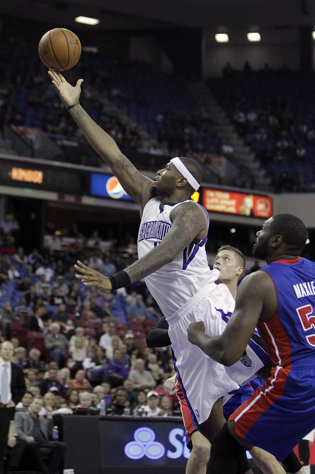 Sacramento Kings center DeMarcus Cousins, left, goes to the basket past Detroit Pistons forward Jason Maxiell, right, during the second half of an NBA basketball game in Sacramento, Calif., Wednesday, Nov. 7, 2012. The Kings won 105-103.(AP Photo/Rich Pedroncelli)