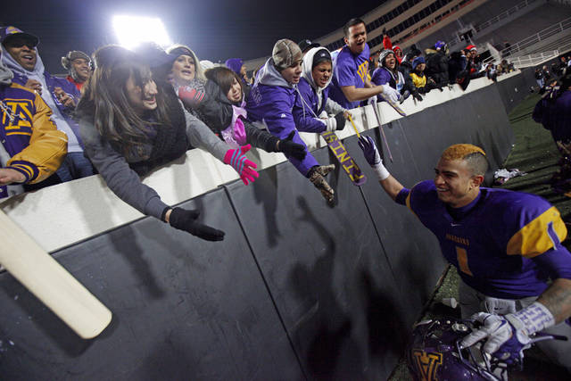 Anadarko's Sheldon Wilson celebrates with the crowd after a touchdown during the Class 3A high school football state championship game between Cascia Hall and Anadarko at Boone Pickens Stadium in Stillwater, Friday, Dec. 9, 2011. Anadarko won 35-18. Photo by Bryan Terry, The Oklahoman