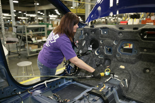 In this April 25, 2012 photo, Tammy Ballard works on a Chevrolet Sonic at the General Motors Orion Assembly plant in Orion Township, Mich. Nearly four years after GM filed for bankruptcy protection, the automaker is building the Sonic, the best-selling subcompact car in the nation. It's a vehicle no one thought could be made profitably in the U.S., by a company that few people thought would last. (AP Photo/Duane Burleson)