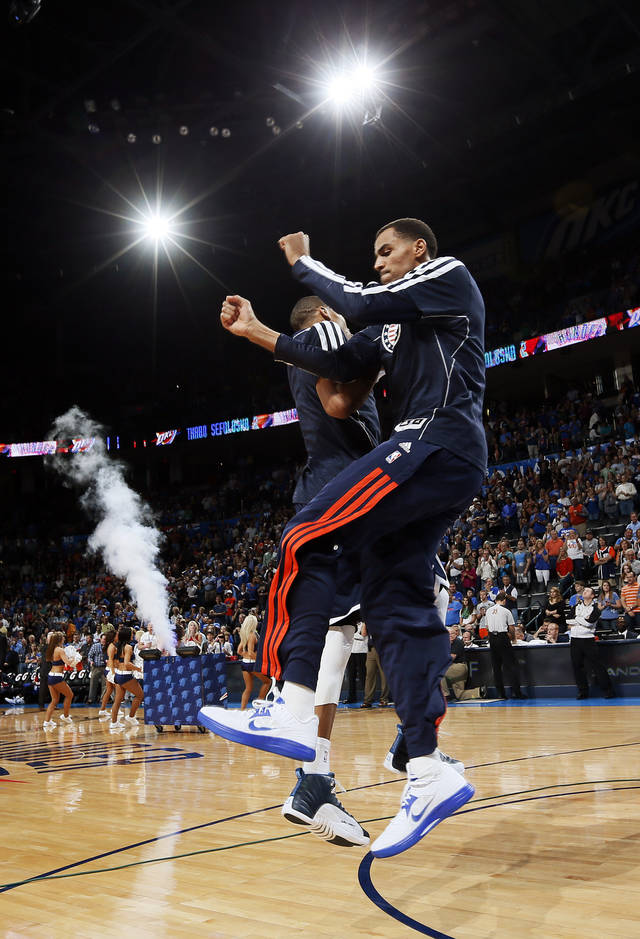 Oklahoma City's Thabo Sefolosha (2) leaps with Russell Westbrook (0) during player introductions before an NBA basketball game between the Detroit Pistons and the Oklahoma City Thunder at the Chesapeake Energy Arena in Oklahoma City, Friday, Nov. 9, 2012. Oklahoma City won, 105-94. Photo by Nate Billings, The Oklahoman