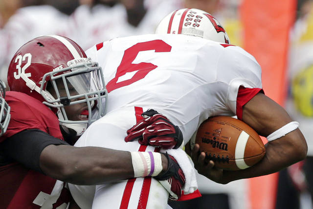FILE - In this Sept. 8, 2012, file photo, Alabama linebacker C.J. Mosley (32) sacks Western Kentucky quarterback Kawaun Jakes (6) during the first half of an NCAA college football game at Bryant Denny Stadium in Tuscaloosa, Ala. Coach Nick Saban says Mosley has gotten bigger and stronger and improved against the run but is especially strong in coverage. Saban says Mosley has been the most productive player on the nation's No. 1 scoring defense.(AP Photo/Dave Martin, File)