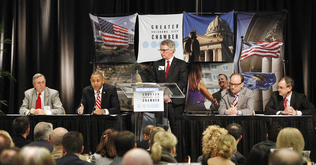 Speaker of the House T.W.  Shannon, second from left, responds to a question while participating in a panel discussion with Sen. Brian Bingman, panel moderator David Rainbolt, vice chairman of government relations for the Greater Oklahoma City Chamber, Rep. Scott Inman and Sen. Sean Burrage during the 2013 Legislative Breakfast sponsored by the Greater Oklahoma City Chamber in Oklahoma City Thursday, Jan. 31, 2013. Photo by Paul B. Southerland, The Oklahoman