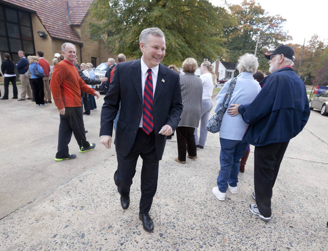 U.S. Rep. Tim Griffin, R-Ark., center, walks past voters after arriving at his poling place in Little Rock, Ark., Tuesday, Nov. 6, 2012. Griffin is being challenged by Democrat Herb Rule in the general election. (AP Photo/Danny Johnston)