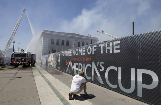 "Firefighters with the San Francisco Fire Department battle a fire at Pier 29 on the waterfront in San Francisco, Wednesday, June 20, 2012. Fire Department spokeswoman Mindy Talmadge says more than 100 firefighters are trying to ""surround the fire and drown it out."" Talmadge says no injuries have been reported. (AP Photo/Paul Sakuma)"