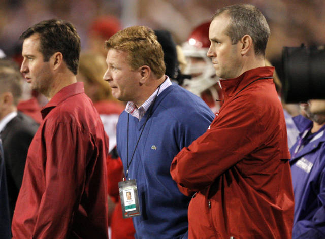 Mike Stoops watches game action during the Insight Bowl college football game between the University of Oklahoma (OU) Sooners and the Iowa Hawkeyes at Sun Devil Stadium in Tempe, Ariz., Friday, Dec. 30, 2011. Photo by Sarah Phipps, The Oklahoman