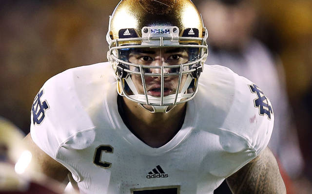 FILE - In this Nov. 10, 2012, file photo, Notre Dame linebacker Manti Te'o waits for the snap during the second half of their NCAA college football game against Boston College in Boston. A story that Te'o's girlfriend had died of leukemia -- a loss he said inspired him to help lead the Irish to the BCS championship game -- was dismissed by the university Wednesday, Jan. 16, 2013, as a hoax perpetrated against the linebacker. (AP Photo/Winslow Townson, File)