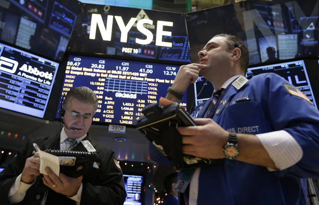 In this Wednesday, Dec. 26, 2012, photo, Daniel Kryger, left, and Kevin Lodewick Jr., right, work on the floor of the New York Stock Exchange in New York. Stocks are edging higher on Thursday as hopes dim that a budget deal will be reached before a deadline at the end of the year. (AP Photo/Kathy Willens)