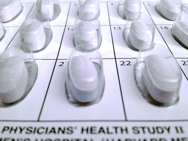 This Oct. 11, 2012 file photo provided by the Brigham and Women's Hospital shows a monthly calendar vitamin pack used in a long-term study on multivitamins. Multivitamins might help lower the risk for cancer in healthy older men but do not affect their chances of developing heart disease, new research suggests. (AP Photo/Brigham and Women's Hospital, File)