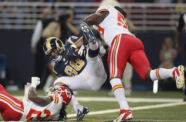 St. Louis Rams tight end Lance Kendricks crosses the goal line on a 23-yard touchdown reception as he is tackled by Kansas City Chiefs' Kendrick Lewis, left, and Jovan Belcher during the first quarter of a preseason NFL football game Saturday, Aug. 18, 2012, in St. Louis. (AP Photo/St. Louis Post-Dispatch, Chris Lee) EDWARDSVILLE OUT ALTON OUT