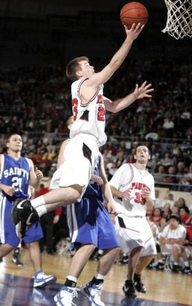 Pawnee's Keiton Page shoots a layup against Oklahoma Christian in the Class 2A boys state basketball championship on Saturday, March 8, 2008, at the State Fair Arena. BY SARAH PHIPPS, THE OKLAHOMAN