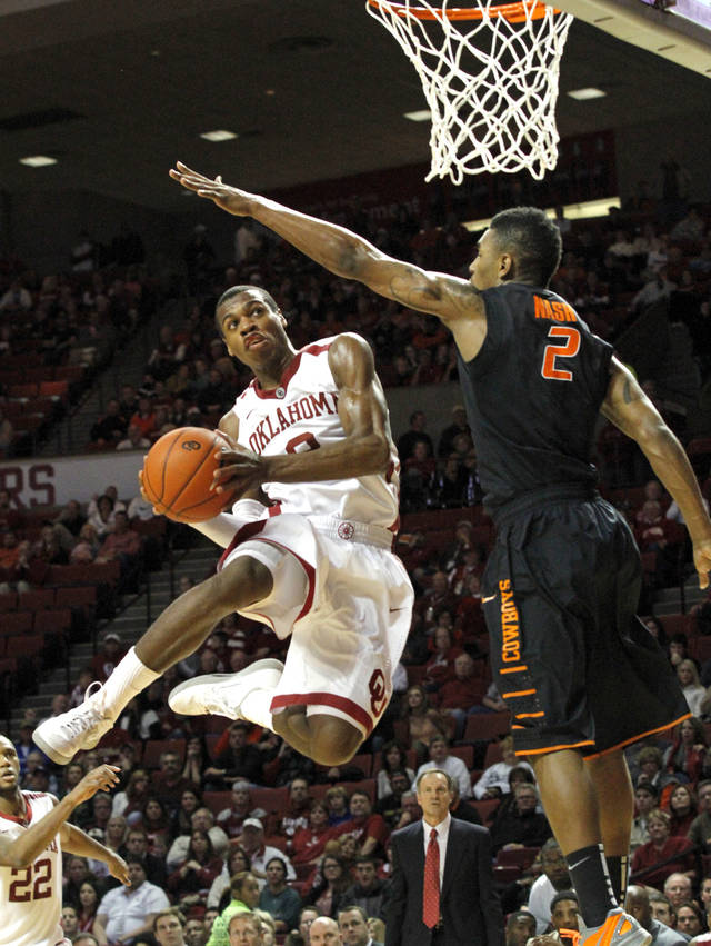 Sooner's Buddy Hield (3) shoots guarded by Cowboy's Le'Bryan Nash (2) during the second half as the University of Oklahoma Sooners (OU) defeat  the Oklahoma State Cowboys (OSU) 77-68  in NCAA, men's college basketball at The Lloyd Noble Center on Saturday, Jan. 12, 2013  in Norman, Okla. Photo by Steve Sisney, The Oklahoman