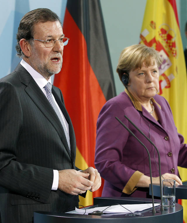 FILE -This is a Thursday, Jan. 26, 2012 file photo of German Chancellor Angela Merkel, right, and the Prime Minister of Spain, Mariano Rajoy, left, as they address the media during a joint news conference at the chancellery in Berlin, Germany. Often these days, the first order of business at European Union summits is not the continent's dreadful financial crisis. It's getting to know the people around the table. The group of national leaders that will meet this week in Brussels is a different crew from the one that met in October 2009, when the crisis in Europe first erupted with the news that Greece was in deep difficulty. (AP Photo/Michael Sohn, File)
