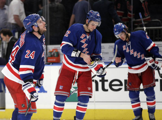 New York Rangers' Ryan Callahan (24), Artem Anisimov (42) and Michael Del Zotto (4) leave the ice after Game 2 of the NHL hockey Stanley Cup Eastern Conference final playoff series against the New Jersey Devils, Wednesday, May 16, 2012, in New York. The Devils won 3-2. (AP Photo/Frank Franklin II)