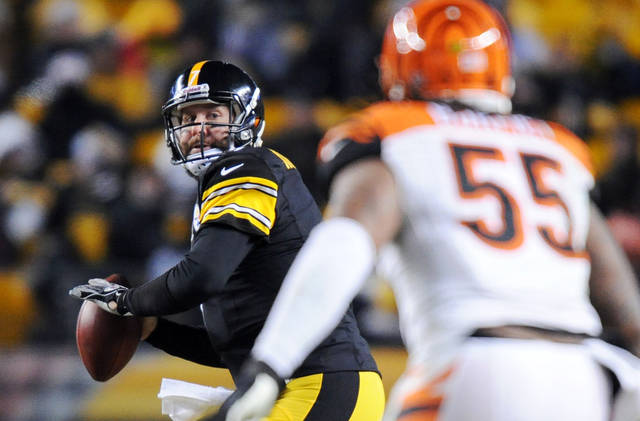 Pittsburgh Steelers quarterback Ben Roethlisberger, left, looks to pass as Cincinnati Bengals outside linebacker Vontaze Burfict (55) defends in the third quarter an NFL football game on Sunday, Dec. 15, 2013, in Pittsburgh. (AP Photo/Don Wright)