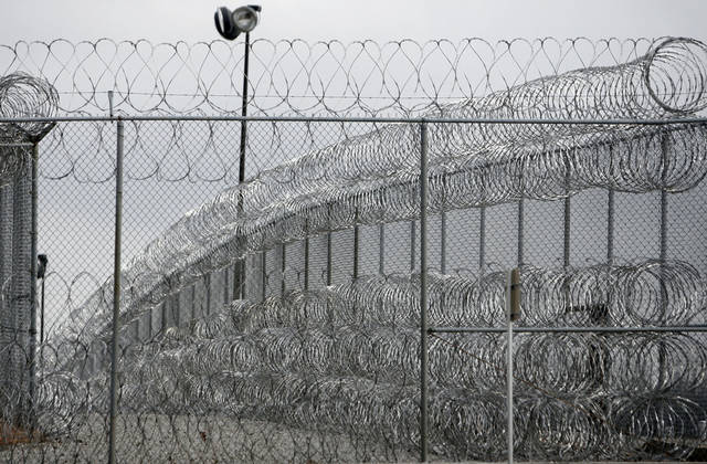 PRISON: Security fence is pictured at the Joseph Harp Correctional Center in Lexington, Okla., on Friday, January 4, 2008. BY SARAH PHIPPS, THE OKLAHOMAN ORG XMIT: KOD