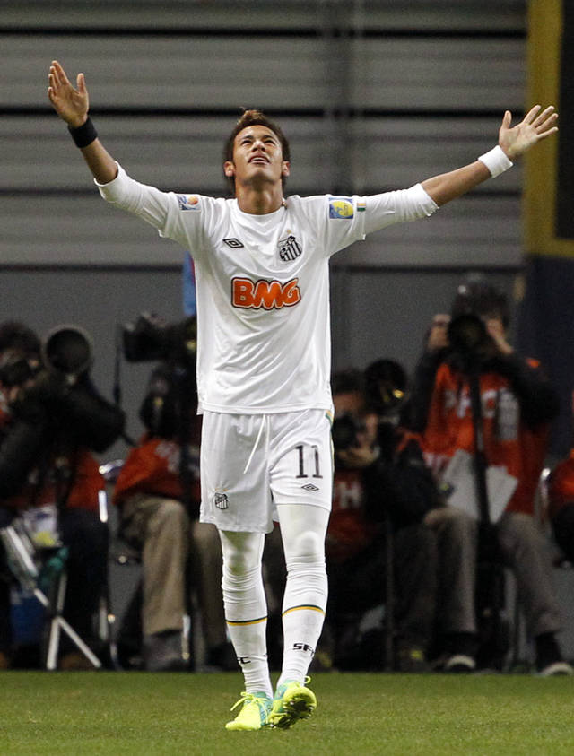 Brazil's Santos FC forward Neymar celebrates after scoring a goal against Japan's Kashiwa Reysol during the semifinal at the Club World Cup soccer tournament in Toyota, central Japan, Wednesday, Dec. 14, 2011. (AP Photo/Koji Sasahara)
