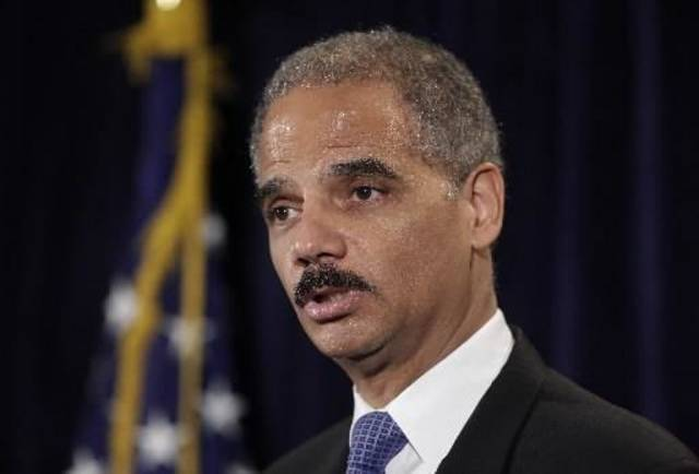 Attorney General  Eric  Holder answers questions from the media after he announced Recovery Act funds for the the Justice Department's Southwest border strategy during a news conference in Los Angeles, Wednesday, July 15, 2009. (AP Photo/Jae C. Hong)