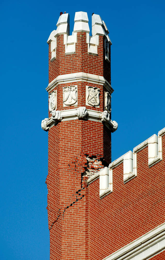 Damage is apparent to this tower (turret) atop Benedictine Hall on the campus of St. Gregory's University in Shawnee on Tuesday, Nov. 15, 2011.  The building sustained major damage when earthquakes shook the region earlier this month. Shown is the turret on the northwest corner of the building. Photo by Jim Beckel, The Oklahoman.