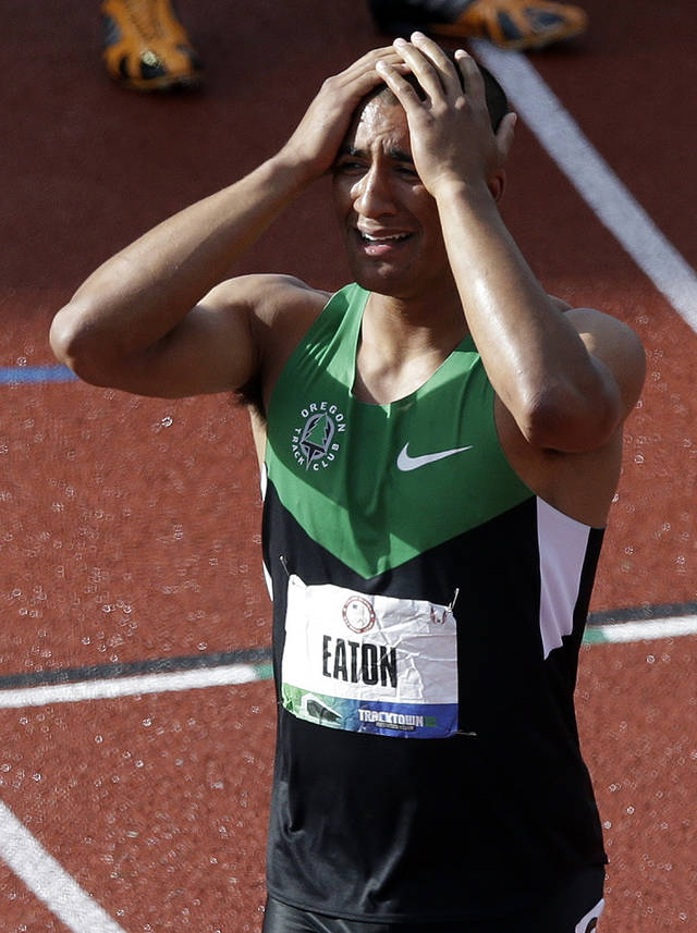 Ashton Eaton reacts after the 1500m during the decathlon competition at the U.S. Olympic Track and Field Trials Saturday, June 23, 2012, in Eugene, Ore. Eaton finished the decathlon with a new world record. (AP Photo/Charlie Riedel)