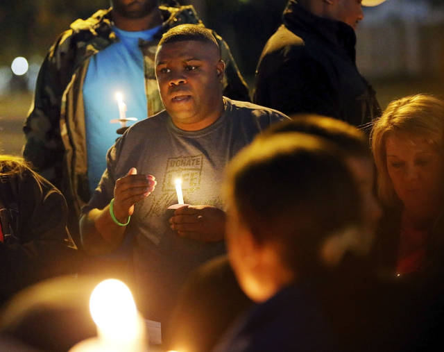 Kittrick Johnson Sr., father of Kittrick Johnson Jr., speaks during a candlelight vigil for Kittrick Johnson Jr., who died after being in a motorcycle accident on the way to school, in Midwest City, Okla., Wednesday, Nov. 7, 2012. Johnson's family is donating his organs to be transplanted and used the vigil to raise awareness of organ donation as well as remembering Johnson. Photo by Nate Billings, The Oklahoman
