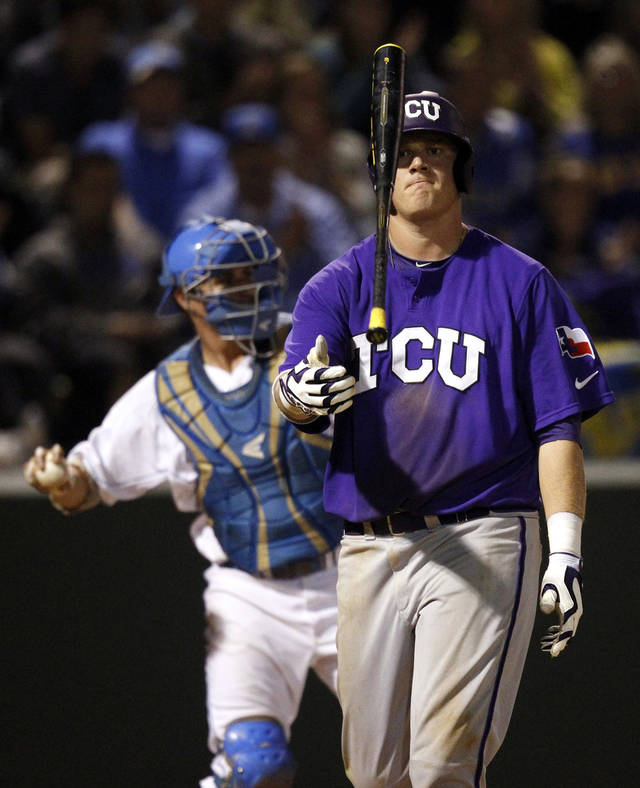 TCU's Kevin Cron tosses his bat after he struck out in the eighth inning of an NCAA college baseball tournament super regional game against UCLA in Los Angeles, Friday, June 8, 2012. (AP Photo/Jae C. Hong)