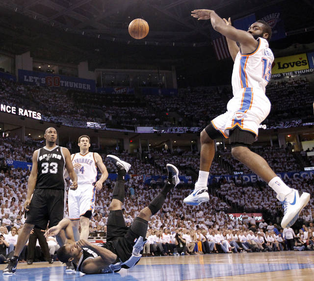 San Antonio's Gary Neal (14) hits the court as he tries to defend on Oklahoma City's James Harden (13) during Game 6 of the Western Conference Finals between the Oklahoma City Thunder and the San Antonio Spurs in the NBA playoffs at the Chesapeake Energy Arena in Oklahoma City, Wednesday, June 6, 2012. Photo by Chris Landsberger, The Oklahoman
