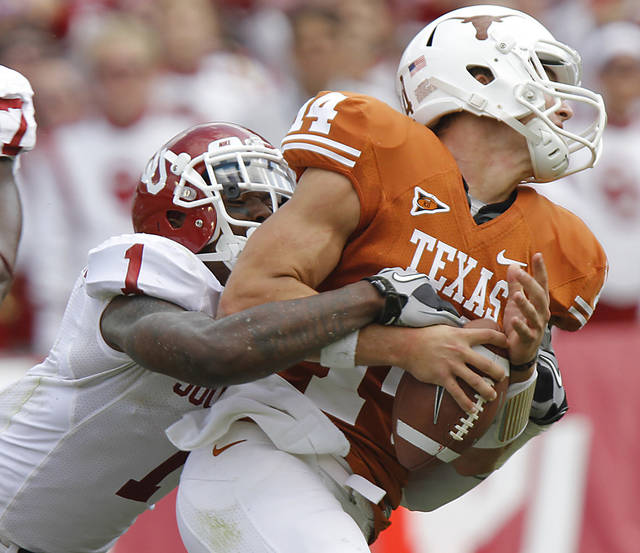 Oklahoma's Tony Jefferson (1) sacks Texas quarterback David Ash (1) during the Red River Rivalry college football game between the University of Oklahoma Sooners (OU) and the University of Texas Longhorns (UT) at the Cotton Bowl in Dallas, Saturday, Oct. 8, 2011. Photo by Chris Landsberger, The Oklahoman