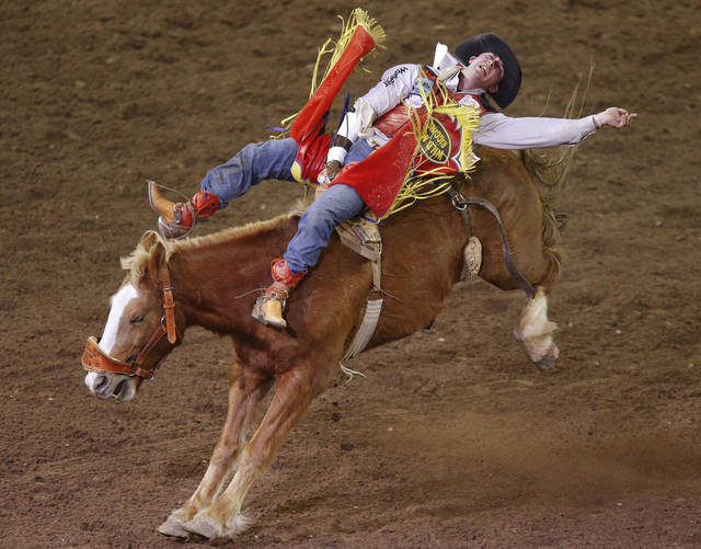 Shawn Minor of Camden, Ohio, rides in the bareback bronc competition in the International Finals Rodeo inside the State Fair Arena in Oklahoma City, Friday, Jan. 18, 2013. Photo by Bryan Terry, The Oklahoman