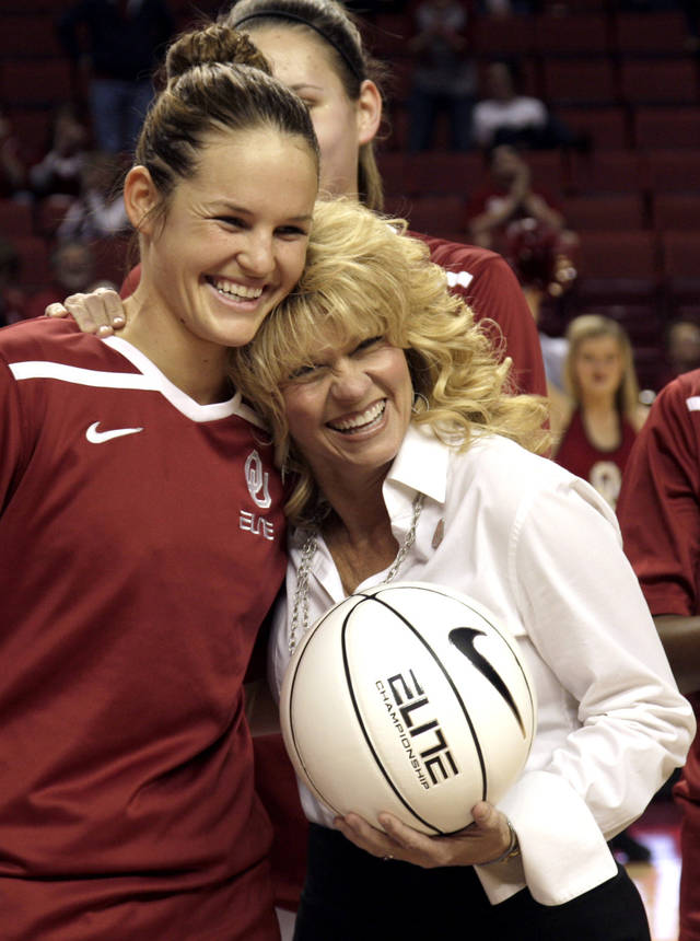 Oklahoma's Whitney Hand and head coach Sherri Coale pose for a photo with a game ball before their 2012 game vs. Kansas. PHOTO BY SARAH PHIPPS, The Oklahoman