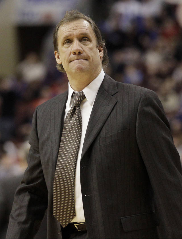 FILE - In this Jan. 13, 2012, file photo, then-Washington Wizards head coach Flip Saunders looks on during a break in an NBA basketball game against the Philadelphia 76ers in Philadelphia. David Kahn is out as president of basketball operations for the Minnesota Timberwolves and Flip Saunders is coming in. Three people with knowledge of the situation tell The Associated Press that team owner Glen Taylor has decided not to pick up the option for next season on Kahn's contract. He is also putting the finishing touches on a deal to hire Saunders as Kahn's replacement.(AP Photo/Matt Slocum, File)