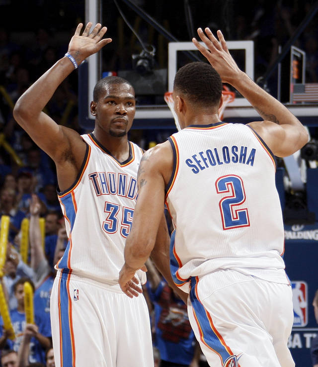 Oklahoma City&#039;s Kevin Durant (35) and Thabo Sefolosha (2) celebrate during game one of the first round in the NBA playoffs between the Oklahoma City Thunder and the Dallas Mavericks at Chesapeake Energy Arena in Oklahoma City, Saturday, April 28, 2012. Oklahoma City won, 99-98. Photo by Nate Billings, The Oklahoman
