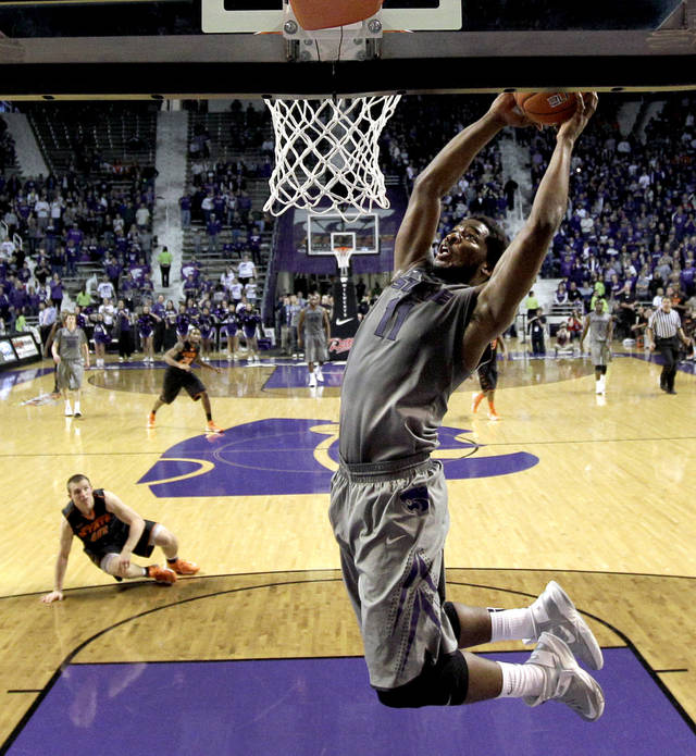Kansas State forward Nino Williams (11) dunks the ball during the second half of an NCAA college basketball game against Oklahoma State, Saturday, Jan. 5, 2013, in Manhattan, Kan. Kansas State won 73-67. (AP Photo/Charlie Riedel) ORG XMIT: KSCR114