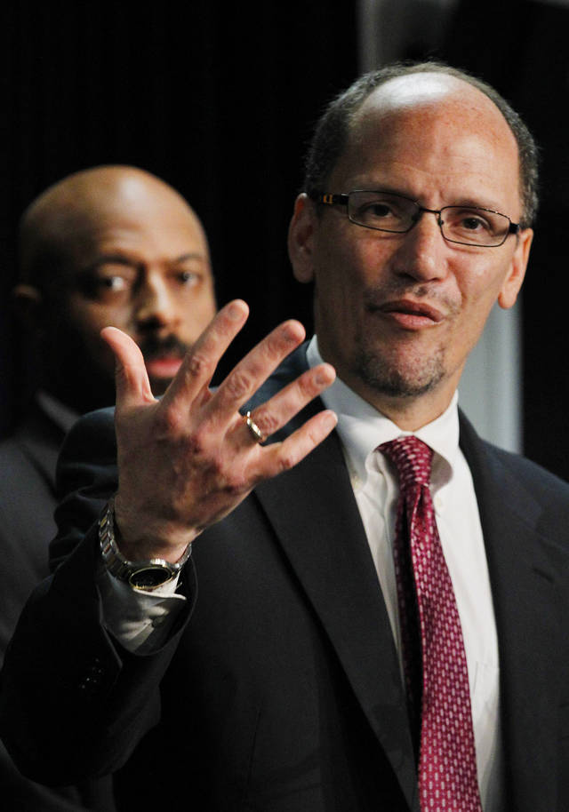 United States Assistant Attorney General Thomas Perez, right, who heads up the civil rights division at the Department of Justice, is joined by Deputy Assistant Attorney General for Civil Rights, Roy Austin, as Perez announces a federal civil lawsuit against Maricopa County Sheriff Joe Arpaio during a news conference Thursday, May 10, 2012, in Phoenix. The announcement comes after months of negotiations failed to yield an agreement to settle allegations that his department racially profiled Latinos in his trademark immigration patrols. (AP Photo/Ross D. Franklin)