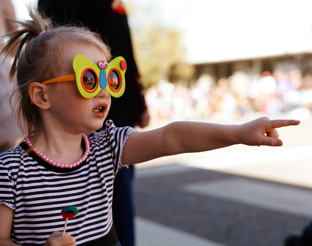 Lucy Jennings, 3, Oklahoma City, points to a clown in the parade. Pleasant temperatures and a deep blue sky  provided a perfect setting for Yukon's 46th annual Oklahoma Czech Festival  Saturday, Oct. 1, 2011.  Thousands of visitors crammed downtown streets to watch the morning parade, eat authentic Czech foods,listen and dance to  music played by polka bands, and buy  fruit-filled kolaches by the dozens. Photo by Jim Beckel, The Oklahoman