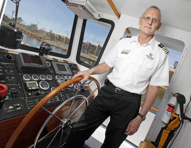 Oklahoma River Boat Capt. Jerry Lojka poses for a photo in the wheelhouse of the Devon Explorer in Oklahoma City, Wednesday, Feb. 22, 2012. Photo by Nate Billings, The Oklahoman