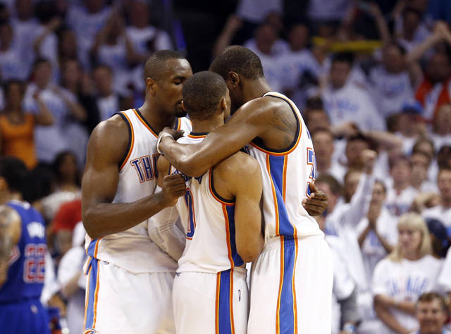 Oklahoma City's Serge Ibaka (9) and Kevin Durant (35) hug Russell Westbrook (0) after he was fouled on a 3-point shot late in the fourth quarter during Game 5 of the Western Conference semifinals in the NBA playoffs between the Oklahoma City Thunder and the Los Angeles Clippers at Chesapeake Energy Arena in Oklahoma City, Tuesday, May 13, 2014. Photo by Sarah Phipps, The Oklahoman